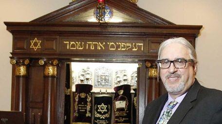 Rabbi Michael Eisenstein is shown in the temple