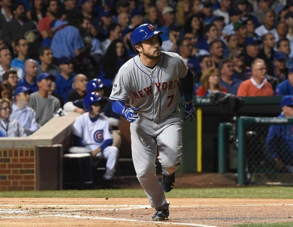 New York Mets catcher Travis d'Arnaud watches his