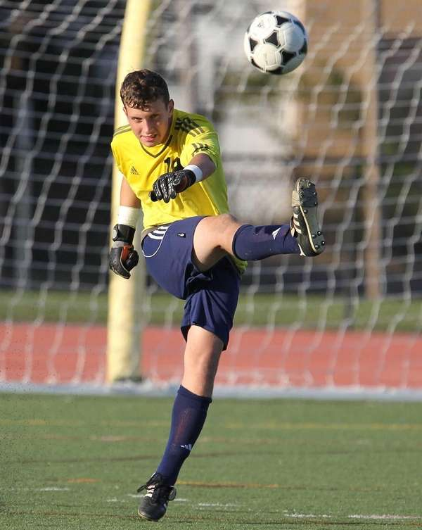 Smithtown West's Aaron Siegel clears the ball in