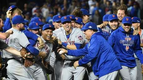 The New York Mets celebrate their NLCS victory