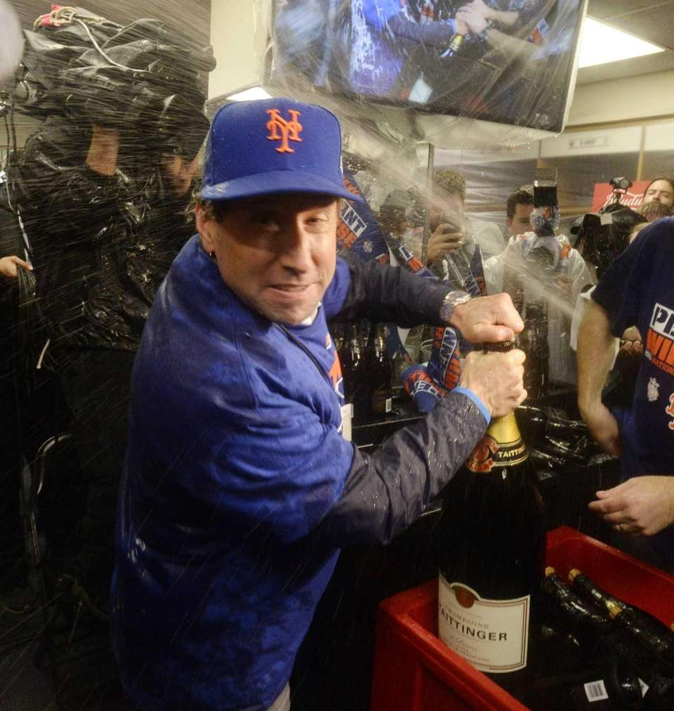 New York Mets owner Jeff Wilpon pops a