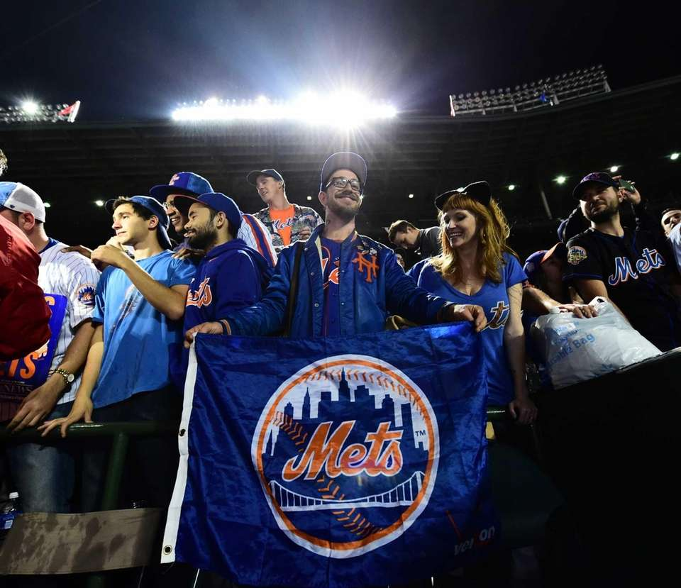 New York Mets fans celebrate their victory in