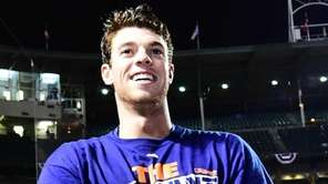 New York Mets pitcher Steven Matz celebrates the