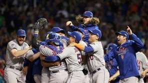 The New York Mets celebrate after defeating the