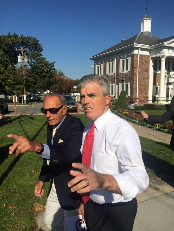 Smithtown Supervisor Patrick Vecchio, left, and Suffolk County