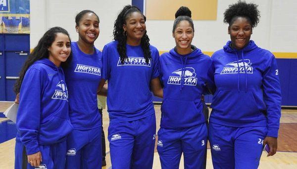 Members of Hofstra Pride's women's basketball team pose