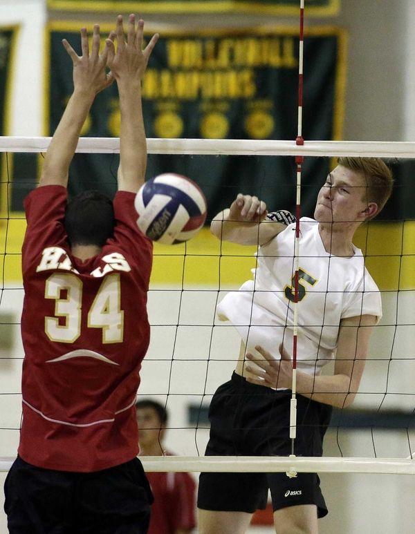 Ward Melville's Chris Allen (5) spikes the ball