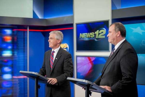 Suffolk County Executive Steve Bellone, right, faces off