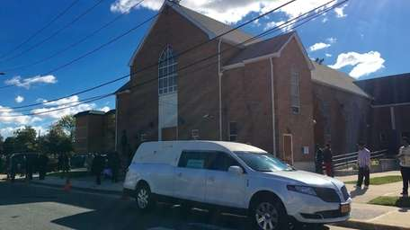 Mourners begin to gather Friday morning, Oct. 23,