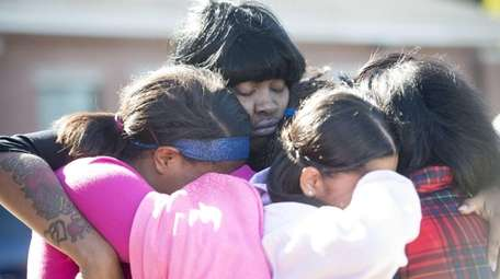 Mourners gather Friday, Oct. 23, 2015 at the