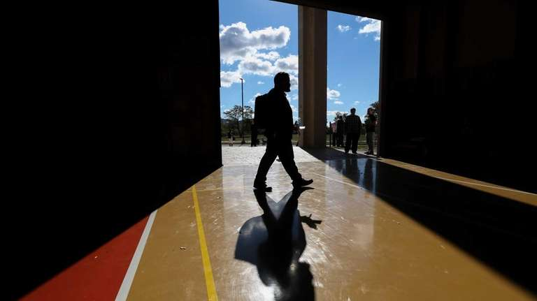 A prospective employee walks through the Nassau County