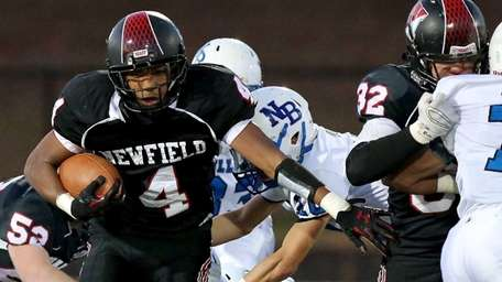 Newfield RB Isaiah Israel carries the ball for