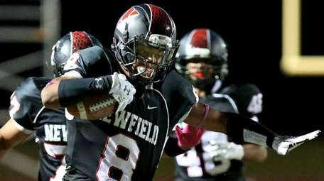 Newfield WR Elijah Riley breaks two tackles on