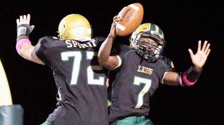 Longwood's Khalil Owens #7 celebrates his touchdown in