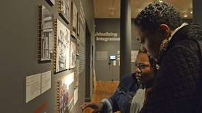 Naomi Leapheart and Kentina Washington tour the exhibit