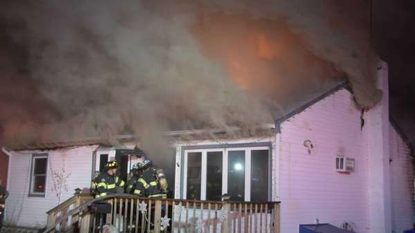 Smoke billows from a West Babylon home on