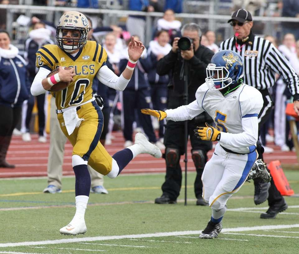 Bethpage's no. 10 Michael Carrello runs past Roosevelt's