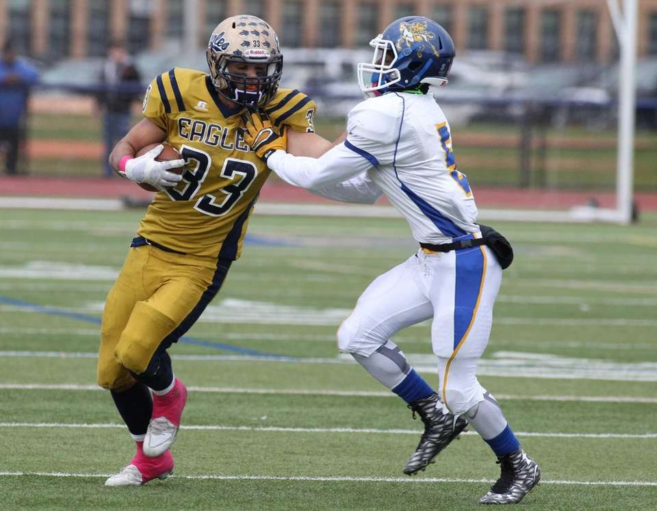 Bethpage's no. 33 Nick Carlino runs past Roosevelt's