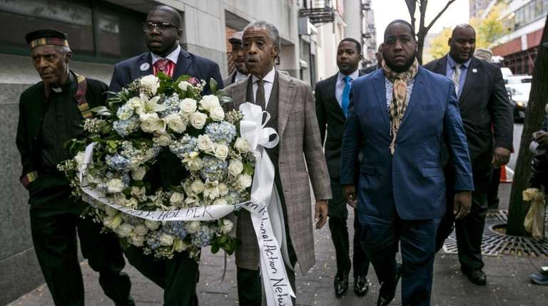 Al Sharpton lays a wreath near a memorial