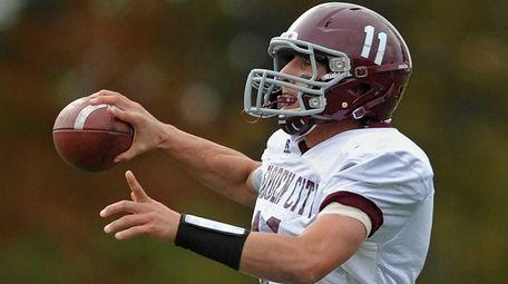 Garden City quarterback No. 11 Tim Schmelzinger looks