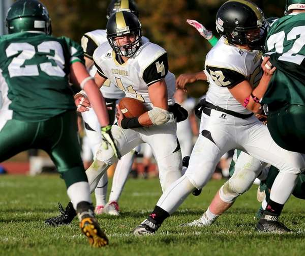 Commack RB Augie Contressa finds the hole and