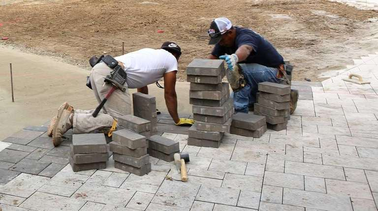 Workers toil to revitalize Geiger Park in Wyandanch