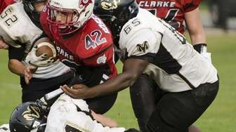 Clarke's Alex Rosenthal (#42) is tackled by West