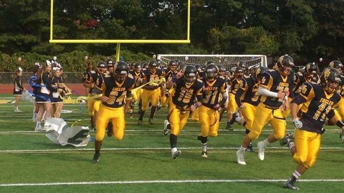 The West Babylon High School Eagles run out