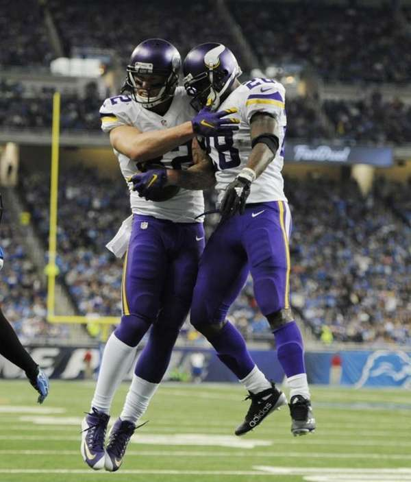 Minnesota Vikings tight end Kyle Rudolph, left, is