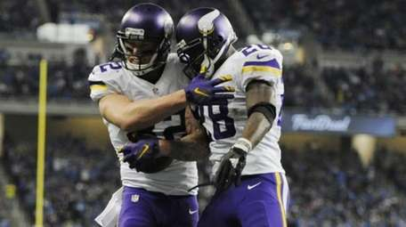 Minnesota Vikings tight end Kyle Rudolph, left, is