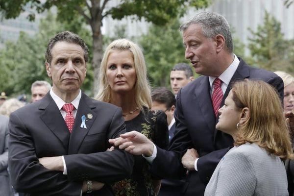 New York Gov. Andrew M. Cuomo, left, listens