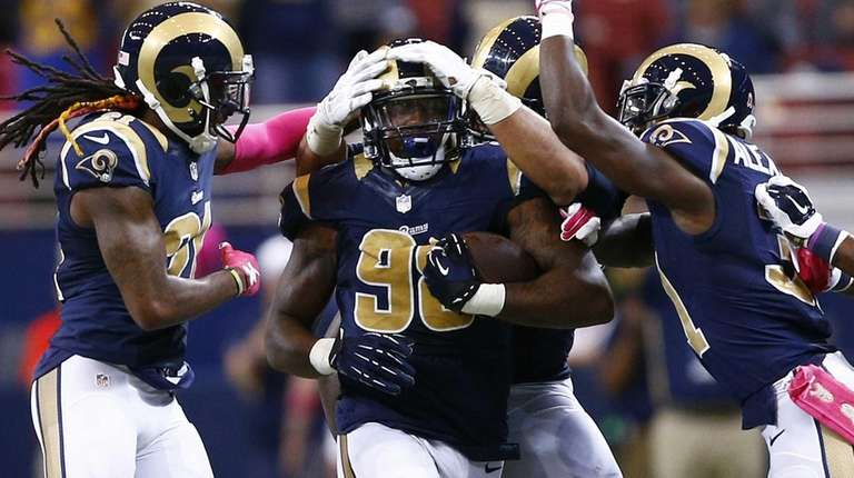 St. Louis Rams defensive tackle Nick Fairley, center,