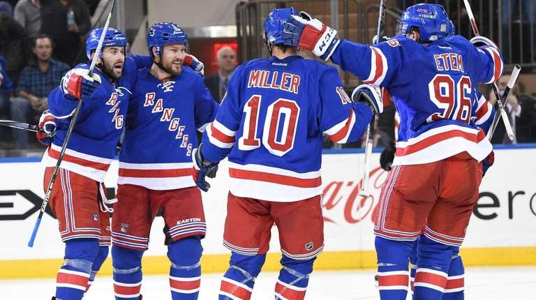The New York Rangers celebrate a goal by