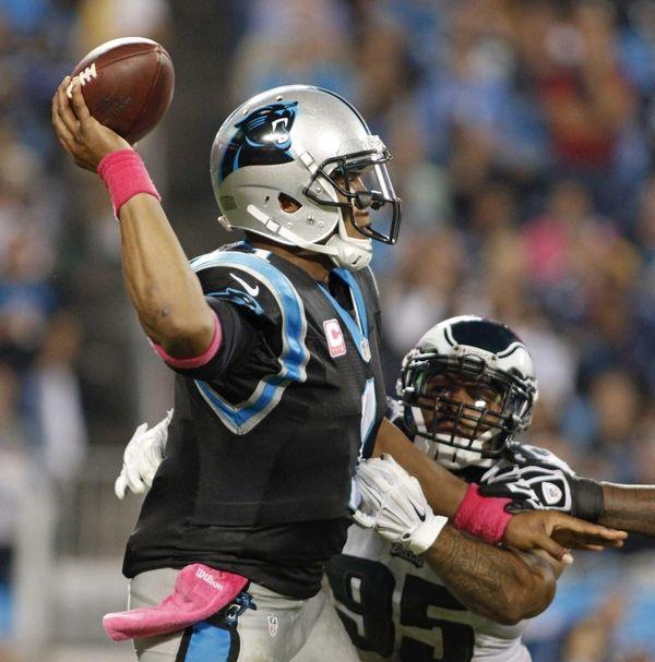 Carolina Panthers' Cam Newton (1) looks to pass