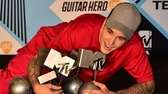 Justin Bieber with his trophies won during the