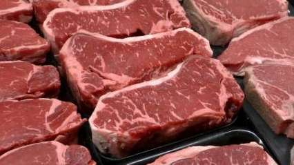 Steaks and other beef products are displayed at