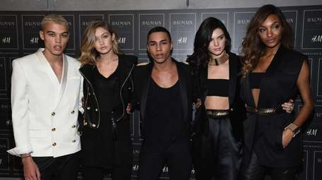 Balmain creative director Olivier Rousteing, center, and models
