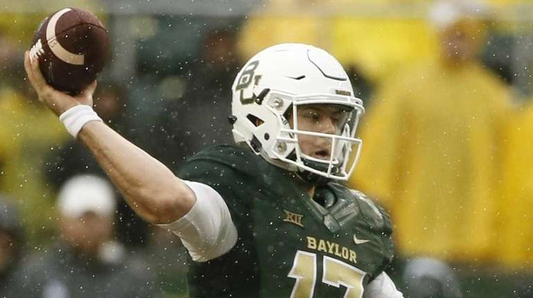 Baylor's Seth Russell throws a pass in the