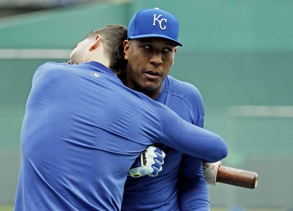 The Kansas City Royals' Eric Hosmer hugs Salvador