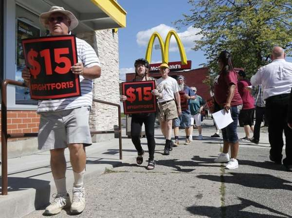 Supporters of a $15 minimum wage for fast