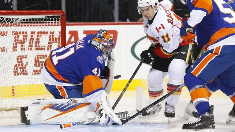 Jaroslav Halak #41 and Johnny Boychuk #55 of