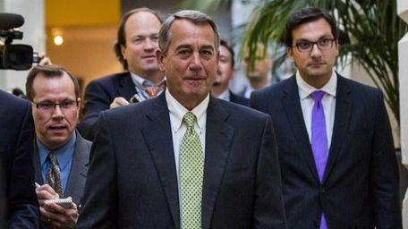 Republican Speaker of the House John Boehner walks