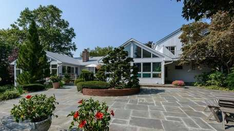 Japanese gardens surround this five-bedroom, five-bathroom home in