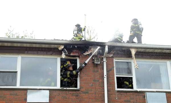 Firefighters battle a fire at the Heritage Gardens
