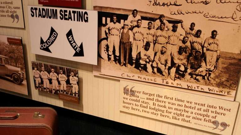 A sign depicting segregated stadium seating on display