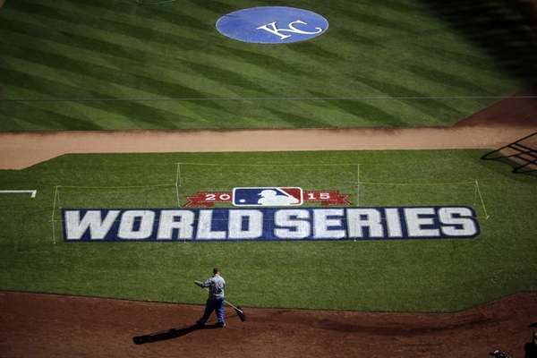 A worker gets Kauffman Stadium ready before media