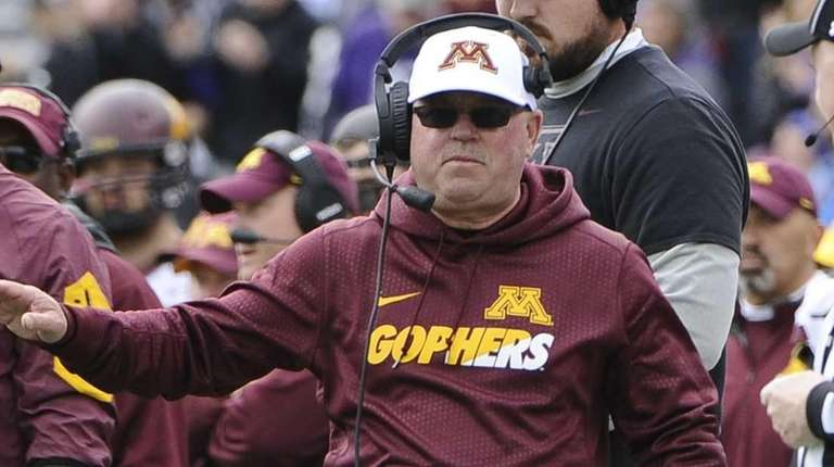 Minnesota head coach Jerry Kill looks on during