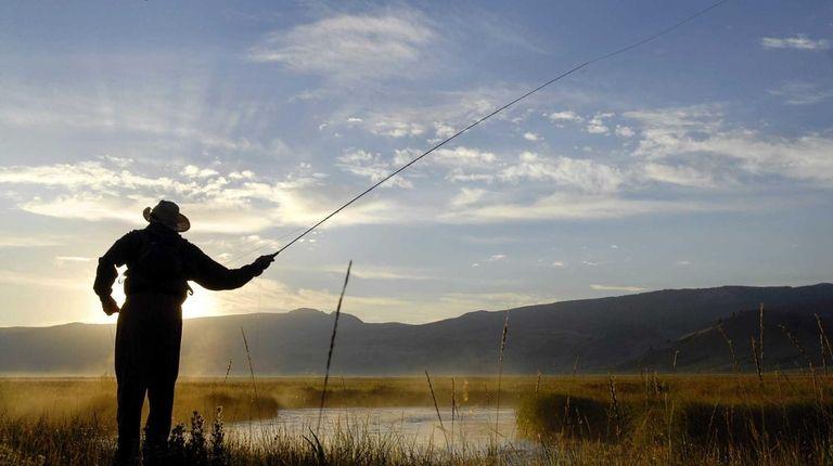 Travis Goodman fishes on Flat Creek, near Jackson,
