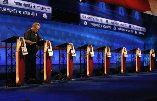 A crew member checks the candidate podiums at