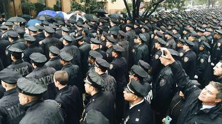 Police officers gather at the Greater Allen A.M.E.